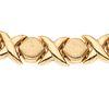 Collar en oro amarillo de 14k. Diseño XO. Broche de caja. Peso: 29.6 g.