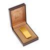 Encendedor Dunhill. Cuerpo en acero dorado, acabado acanalado. Estuche original.