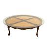 Mesa de centro. SXX. Talla en madera. Con cubierta circular de vidrio, fustes semicurvos y soportes tipo cabriolé. 40 x 146 cm Ø