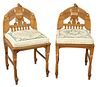 Pair of Egyptian Revival Side Chairs, having bird motif and woven seats with custom cushions, height 34 inches, width 18 inches, depth 19 inches.