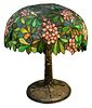Large American Leaded Glass Lamp, having apple blossom conical shade, resting on tree form base with six lights, height 28 inches, diameter 22 inches.