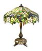 Large American Leaded Glass Peony Table Lamp, having patinated bronze four-light base, supporting shade with purple and white flowers, pale green leaf
