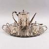Juego de té. SXX. Elaborado en metal plateado. Consta de: charola (52 x 33 cm), tetera, cremera y azucarera. Piezas: 4