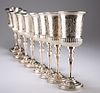 A SET OF EIGHT SILVER-PLATED GOBLETS, each campana bowl par