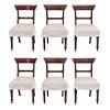 Lote de 6 sillas. SXX. Elaboradas en madera. Con asiento de tela. Respaldos semiabiertos, fustes acanalados y soportes tipo carrete.