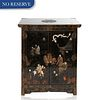A MEIJI PERIOD JAPANESE EBONISED LACQUER CABINET