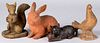 Four pottery and composition animals
