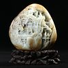 A CELADON AND RUSSET JADE 'LANDSCAPE AND FIGURES' CARVING