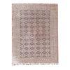 Tapete. SXX. Estilo Boukhara. Elaborado en fibras de lana y algodón. Decorado con elementos geométricos y florales sobre beige.