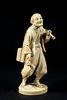 19TH C. JAPANESE IVORY OKIMONO OF MAN WITH PIPE AND CUP