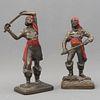 Pareja de bucaneros. SXX. Fundición en antimonio patinado, con detalles en esmalte rojo.  25 cm.