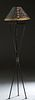 Mario Villa (1953-2021, Nicaragua/New Orleans), Ebonized Steel and Brass Tripodal Floor Lamp, 20th c., on cylindrical legs with disc feet, with a hand