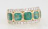 Lady's 14K Yellow Gold Dinner Ring, the top with five square cut emeralds within borders of small round diamonds, total emerald wt.- 3.12 cts., total