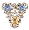 AN EARLY 20TH CENTURY COLOURED SAPPHIRE AND DIAMOND BROOCH, two cushion-cut