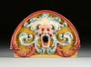 A RENAISSANCE REVIVAL PAINTED WOOD CIRCUS WAGON GROTESQUE MASK PANEL, LATE 19TH CENTURY,