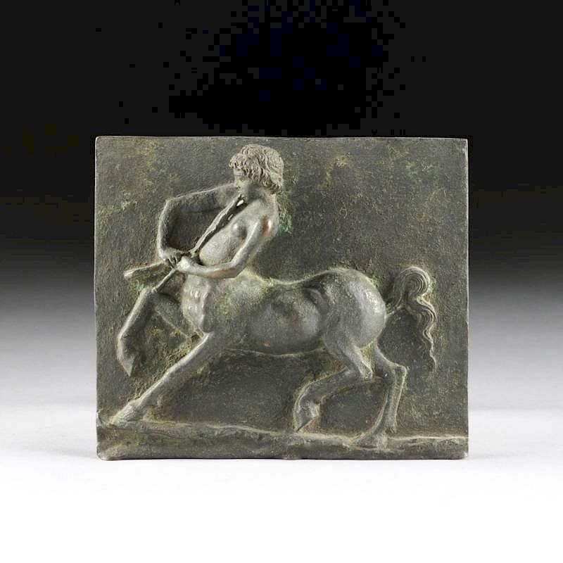 A CONTINENTAL PATINATED BRONZE PLAQUE OF A CENTAUR YOUTH