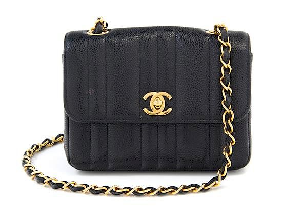 A Chanel Black Caviar Quilted Small Flap Bag, 7