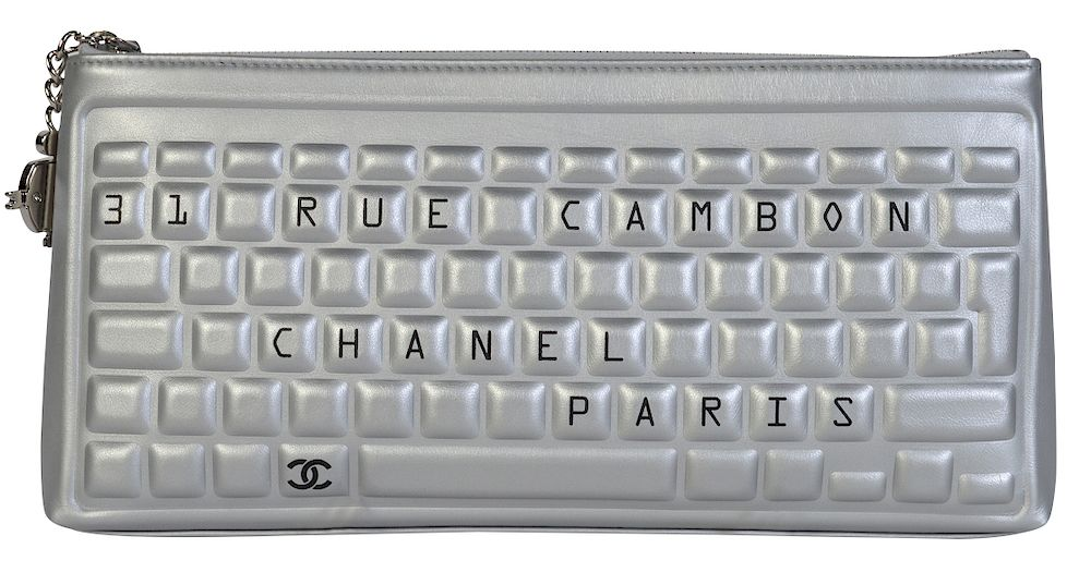 7b76566c5fe6a5 Unique Metallic Calfskin Leather CHANEL Clutch by Abington Auction Gallery,  Inc. - 1146849 | Bidsquare