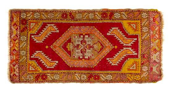 Two Turkish Wool Rugs Larger example: 3 feet 2 1/2 inches