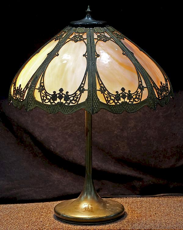 Arts And Crafts Slag Glass Table Lamp Having A Gilt Metal Overlaid