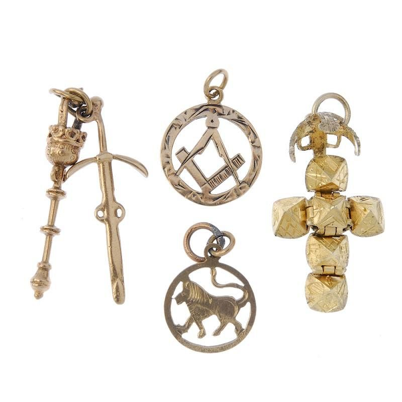 A selection of four charms  To include a 9ct gold sword and